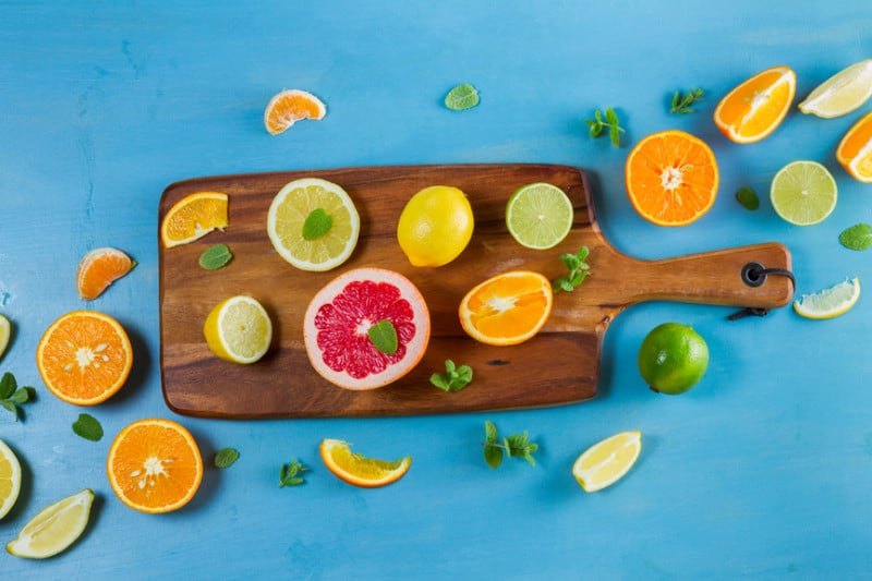 citrus on wooden chopping board