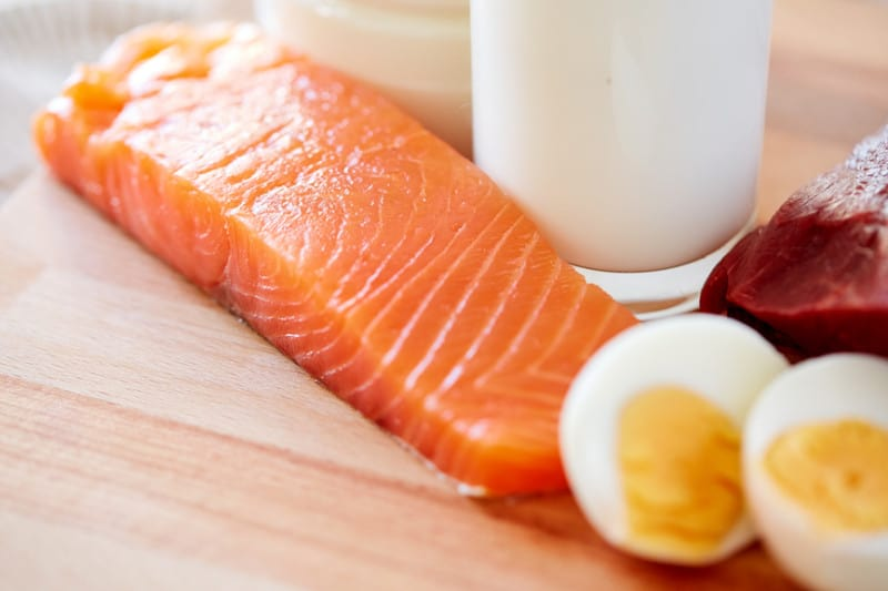 close-up-of-salmon-fillets-eggs-and-milk-on-table