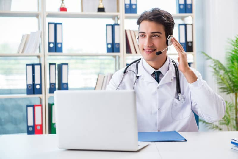 Telemedicine Doctor Consulting with Patient Via Video