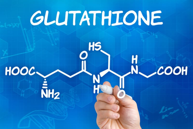 hand-with-pen-drawing-the-chemical-formula-of-glutathione